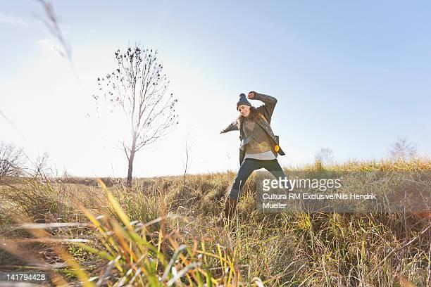 Woman walking in wheatfield