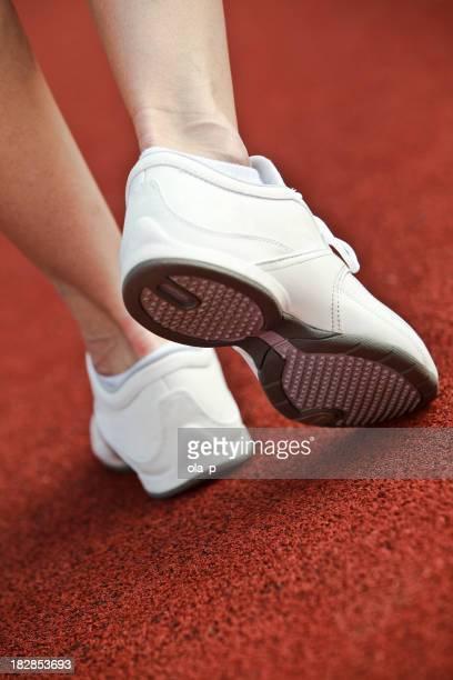 Woman walking in white sports shoe