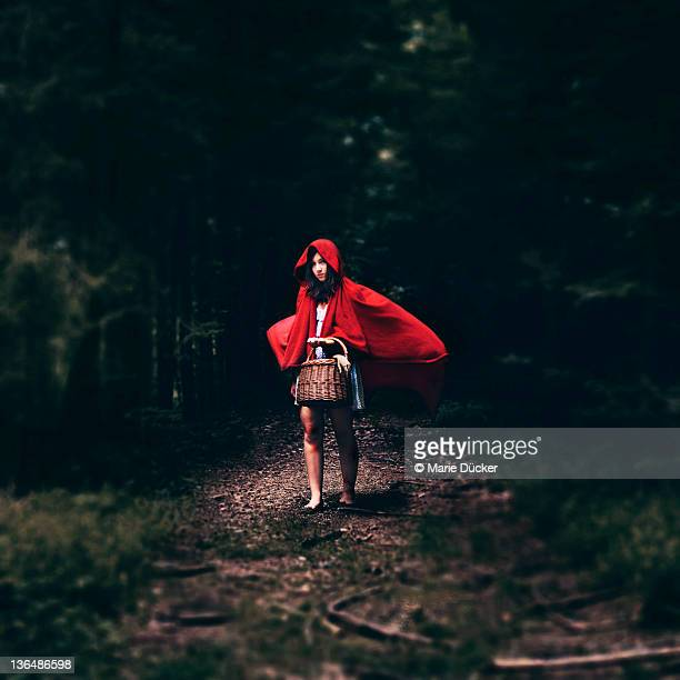 Woman walking in woods at night