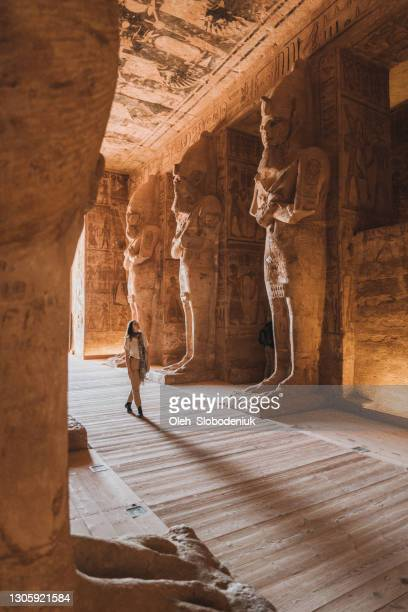 woman walking inside  abu simbel temples - egypt stock pictures, royalty-free photos & images