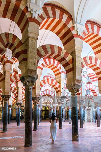 Woman walking inside the Mezquita of Cordoba
