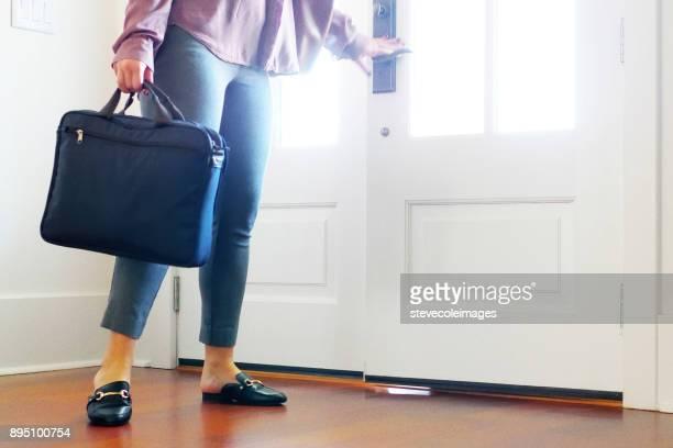 Woman walking into home from front door.