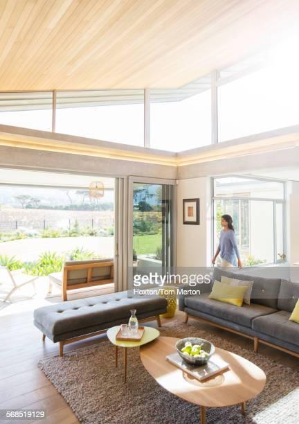 Woman walking into home showcase living room