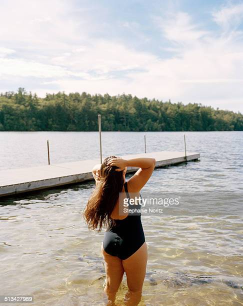 woman walking into lake - lake solitude (new hampshire) stock photos and pictures