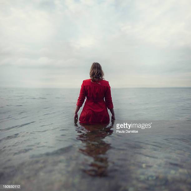 Woman walking into sea