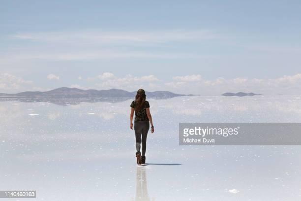 woman walking into the distance - ウユニ ストックフォトと画像