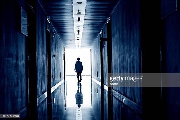 woman walking into the light - red light stockfoto's en -beelden
