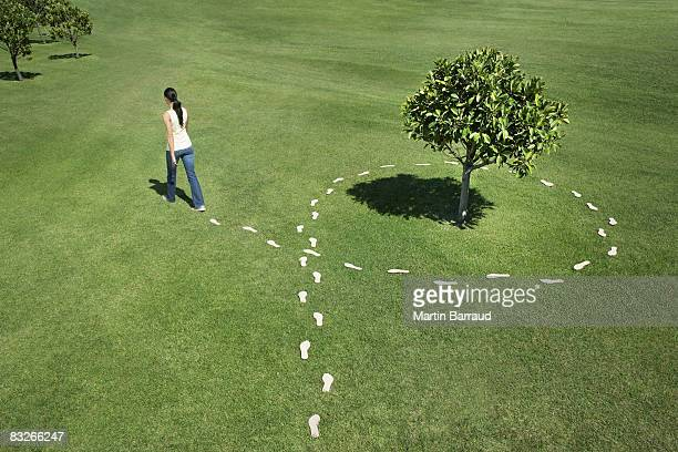 Woman walking leaving trail of footprints