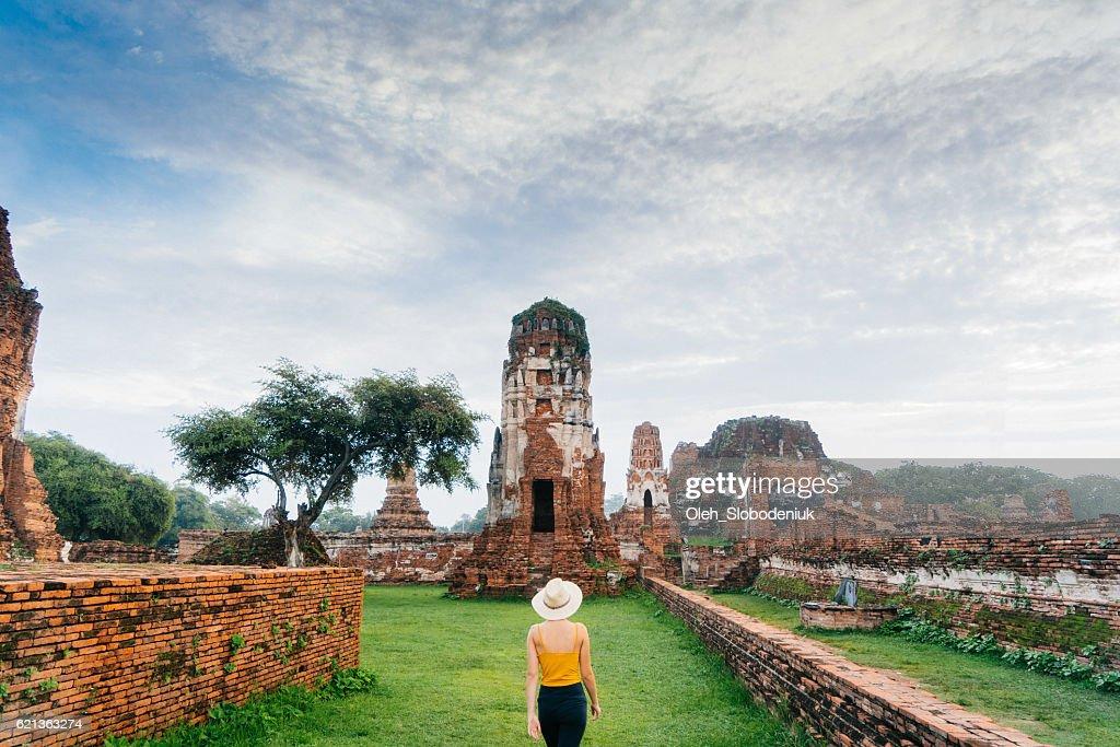 Woman walking near  ancient Buddhist Temple : Stock Photo