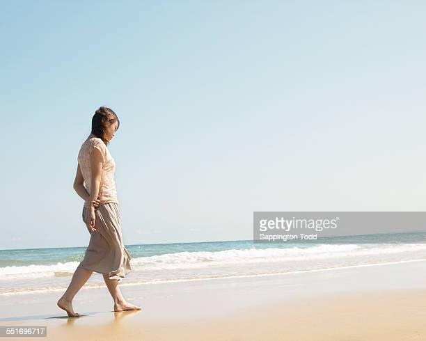 Woman Walking Near Seashore