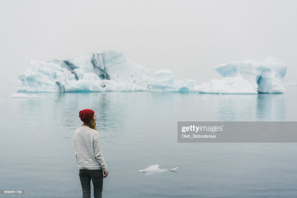 Woman  walking near the Jokulsarlon : Stock Photo