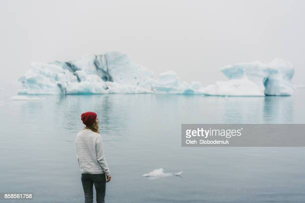 woman  walking near the jokulsarlon - glacier lagoon stock photos and pictures