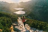 Woman walking   near the lake in Tatra  mountains