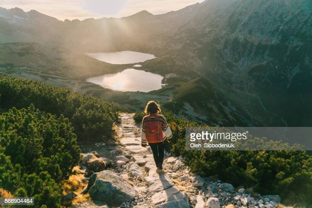 Woman walking   near the lake in Tatra  mountains