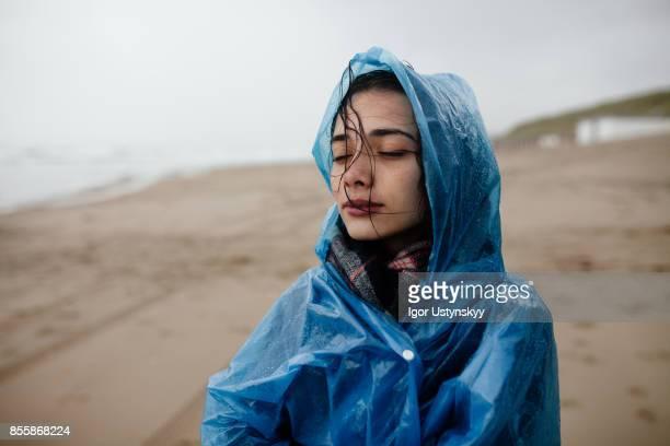 Woman walking  near the sea on Texel Island