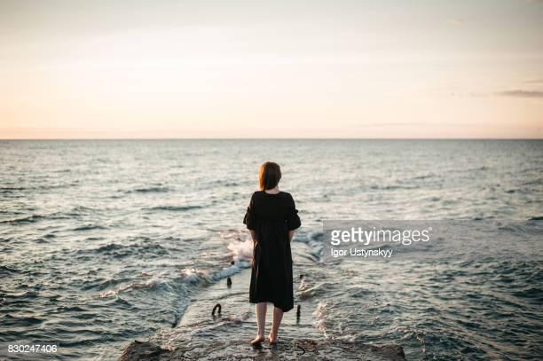 Woman walking  near the sea
