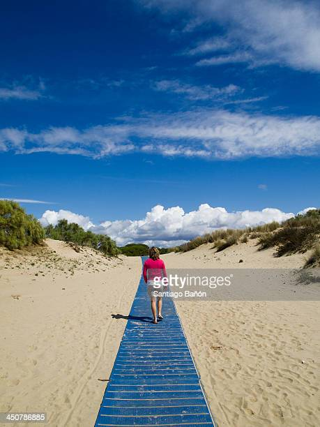 Woman walking on a blue path