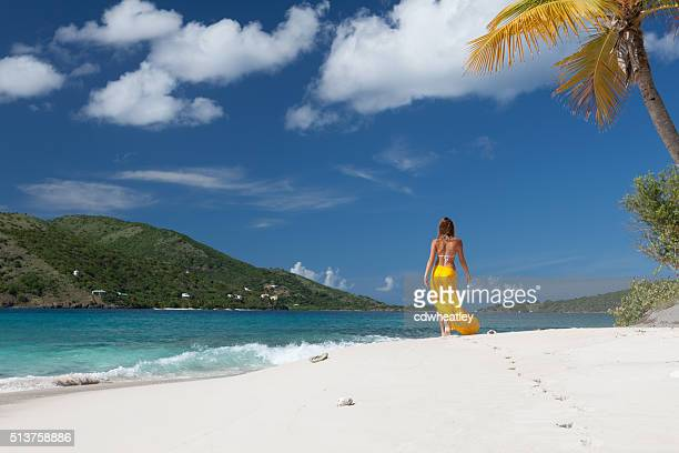 woman walking on a deserted island