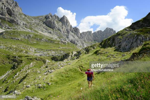 Woman walking on a path in a beautiful mountain