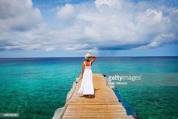 Woman walking on a pier in Curacao