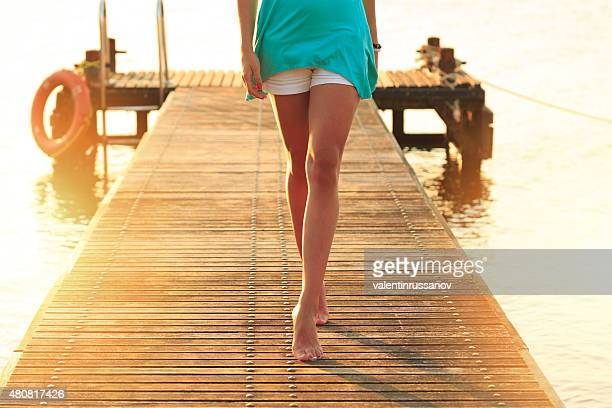 Woman walking on a quay