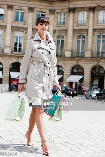 Woman walking on a street, Paris, Ile-de-France, France