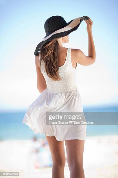 woman walking on beach - sundress stock pictures, royalty-free photos & images
