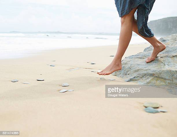 woman walking on beach - barefoot stock pictures, royalty-free photos & images
