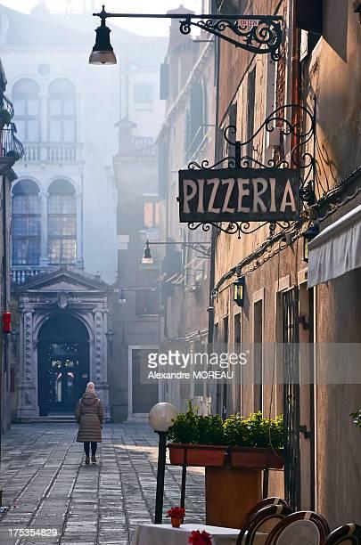 Woman walking on beautiful street in Venice