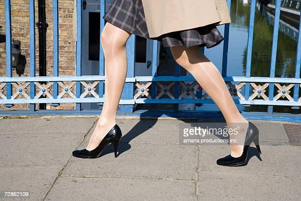 woman walking on bridge (close-up) - パンティストッキング ストックフォトと画像