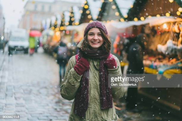woman walking on christmas market - maroon stock pictures, royalty-free photos & images