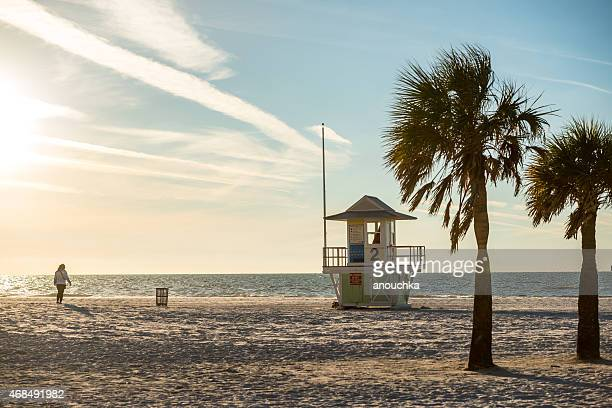 woman  walking on clearwater beach, florida - clearwater beach stock pictures, royalty-free photos & images