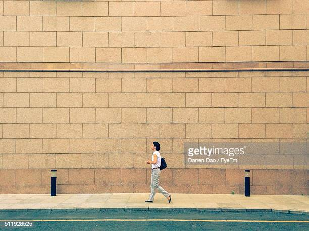 Woman walking on footpath