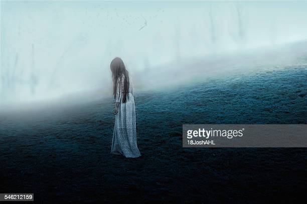 Woman walking on misty hill