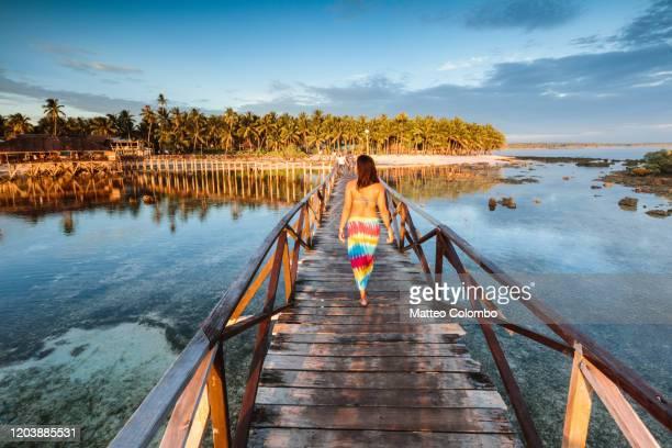woman walking on pier, cloud 9, siargao, philippines - filipino ethnicity and female not male fotografías e imágenes de stock