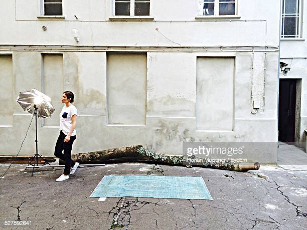 Woman Walking On Road In Front Of Building