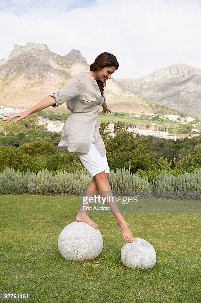 Woman walking on round stones