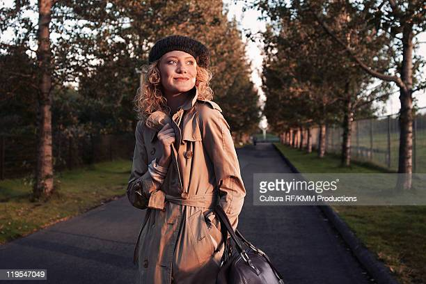 Woman walking on rural road