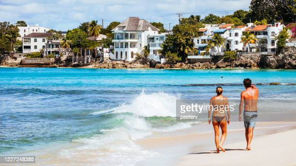 "woman walking on sandy beach - barbados - ""peeter viisimaa"" or peeterv stock pictures, royalty-free photos & images"