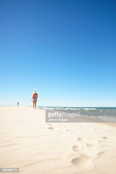 woman walking on sandy beach - gotland bildbanksfoton och bilder