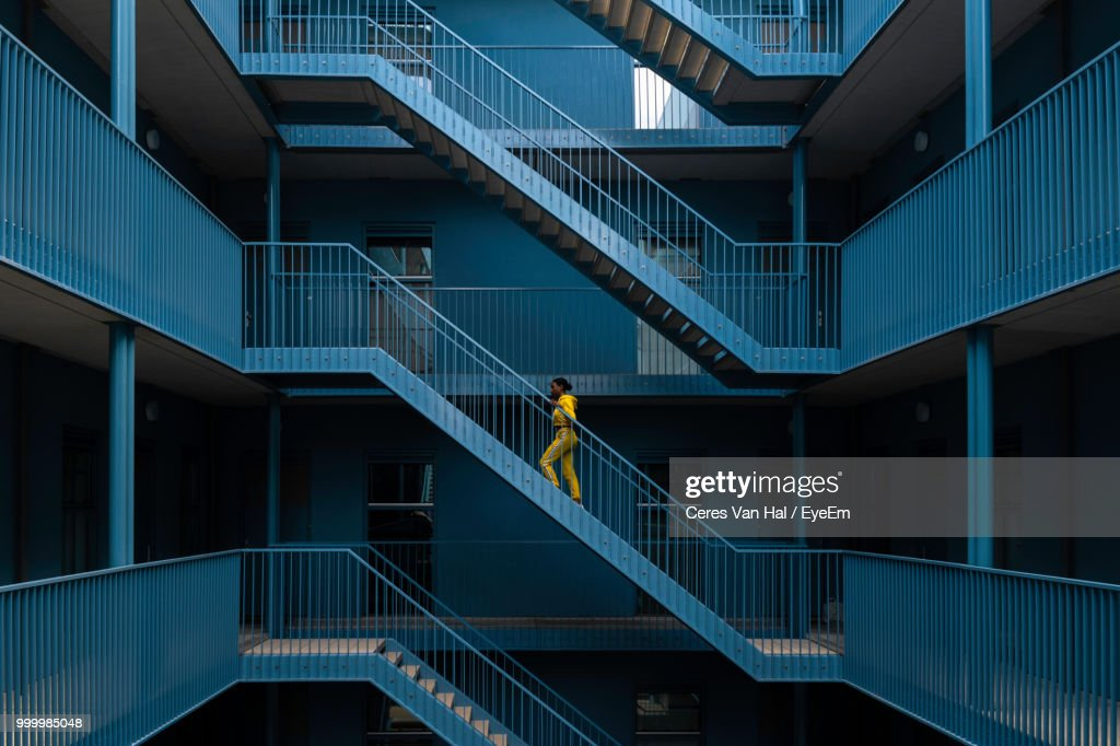 Woman Walking On Staircase Of Building : Stock Photo