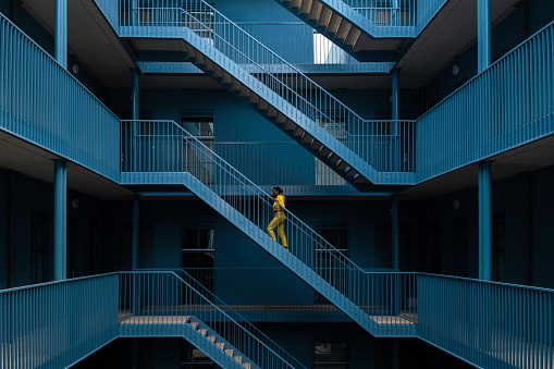 Woman Walking On Staircase Of Building - gettyimageskorea