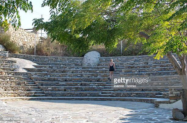 Woman walking on stairs on a Stone made Theatre in Tinos Island (Greece)