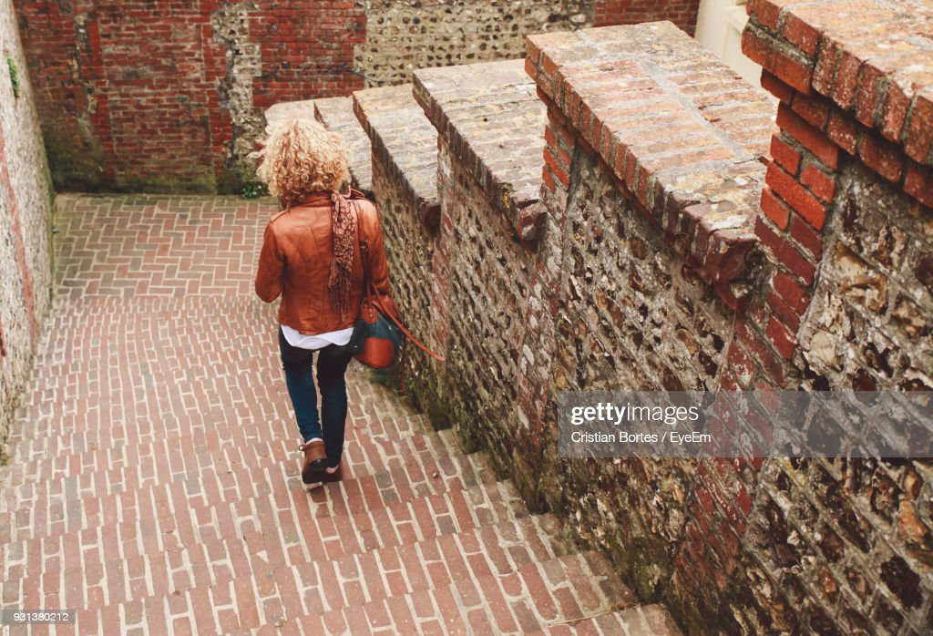 Woman Walking On Steps : Stock Photo