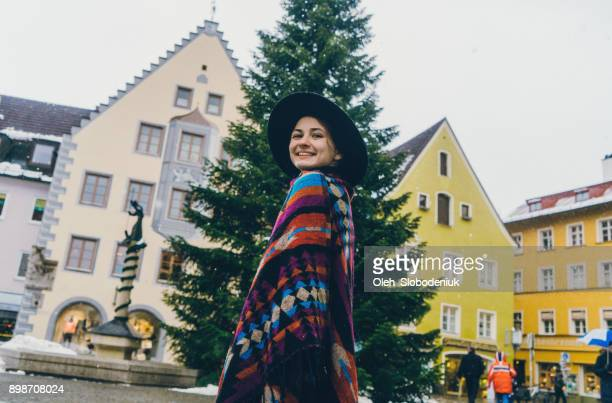 Woman walking on streets of Fussen in winter