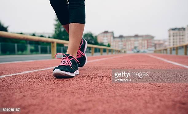 Woman walking on tartan track