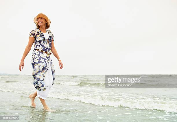 woman walking on the beach - barefoot stock pictures, royalty-free photos & images