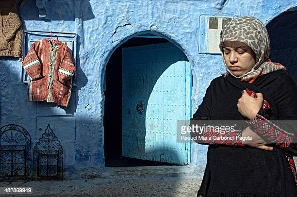 Woman walking on the blue streets