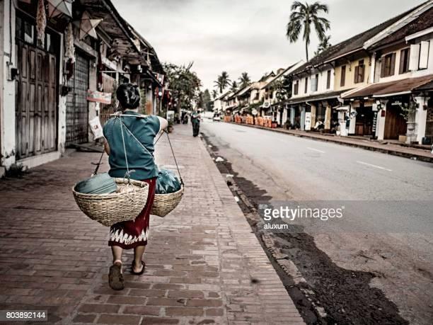 Woman walking on the main street in Luang Prabang Laos
