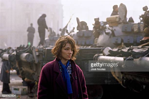 Woman walking on the Palace Square in Bucharest Riots and street violence led the Romanian dictator Nicolae Ceausescu to abandon power and flee...